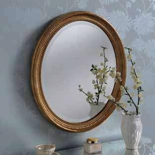 gold oval ornate gilt mirror