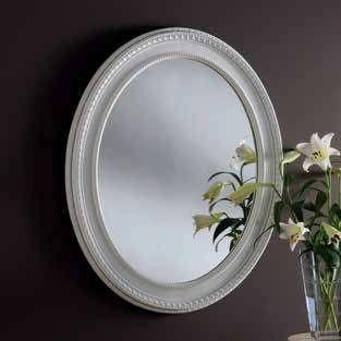 oval white ornate gilt mirror