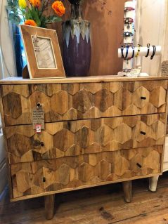 handcarved light mango wood chest of drawers with hexagonal panels