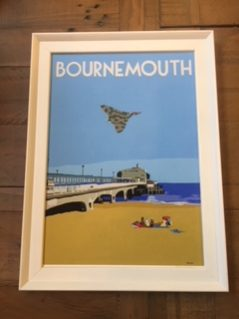 Vintage style framed print of Bournemouth beach with Vulcan bomber