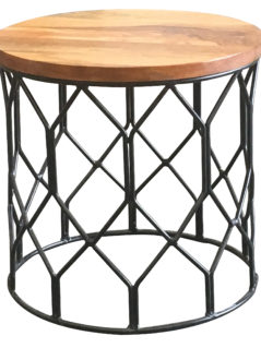 light mango wood side table with a round patterned metal base