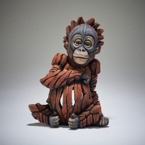 handpainted baby orangutan sculpture