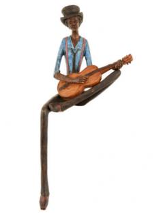 Shelf sitting jazz guitar player figurine
