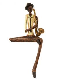 Shelf sitting jazz saxophone player figurine