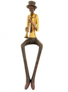 vintage style shelf sitting trumpet player figurine